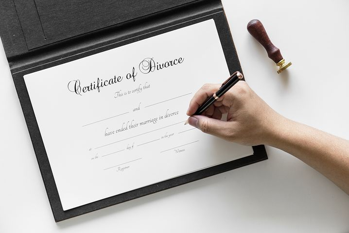 person signing a divorce certificate